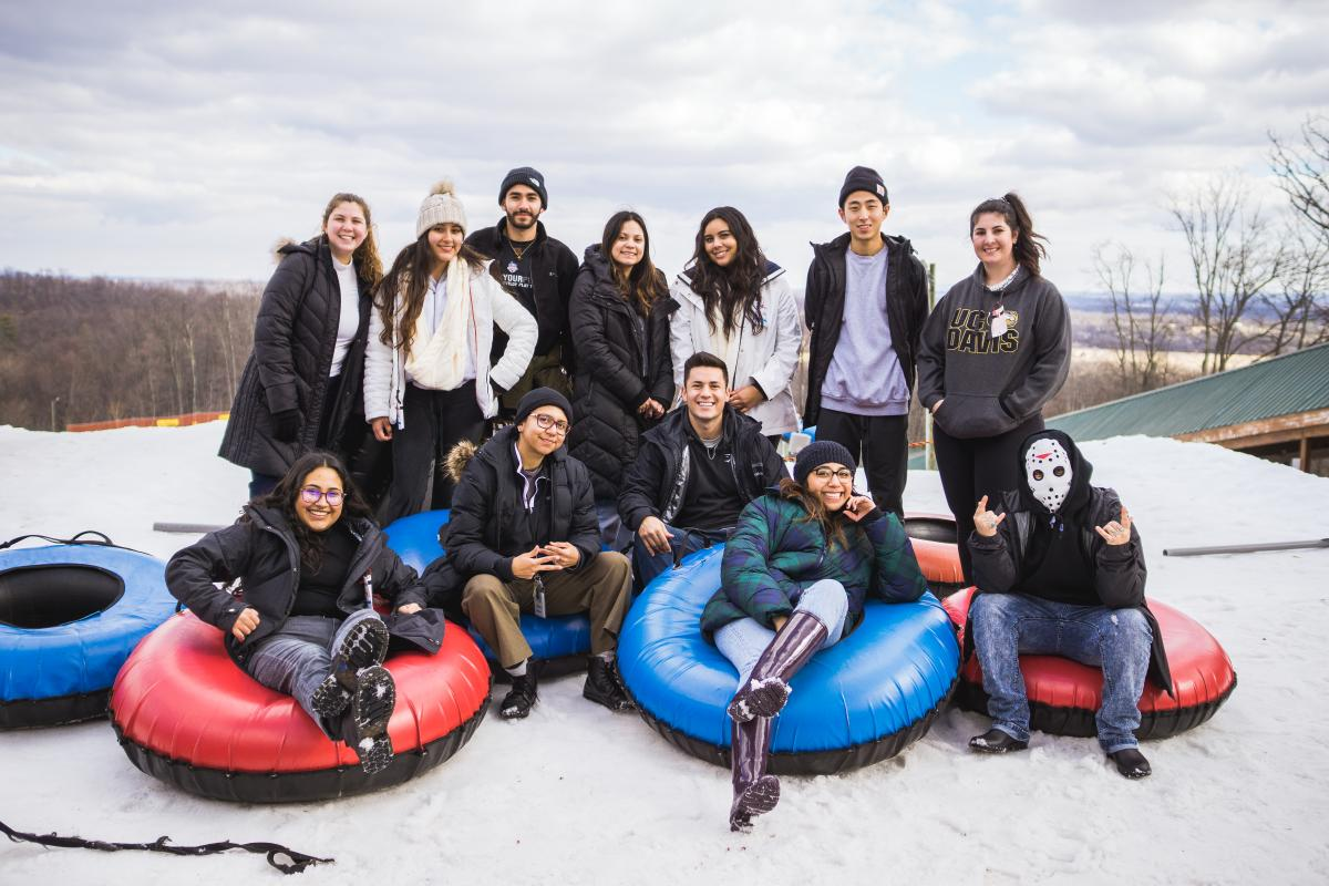 A group of students hanging out on a snow tubing adventure